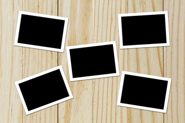 Photo frame blank on wood background with space