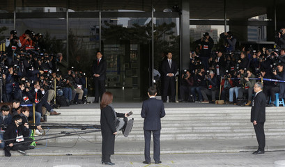 South Korea's former president Lee Myung-bak speaks as he arrives at the prosecutors' office in Seoul