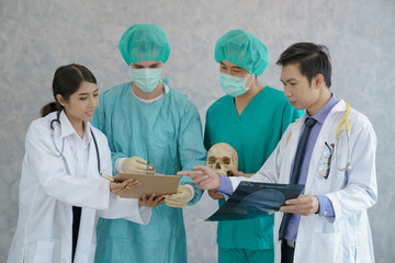 Doctors watching x-ray of patient