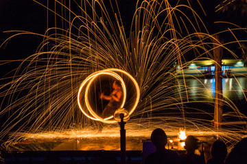 Fire dancing show fireball show amazing at night. Swinging fire in full moon thailand.