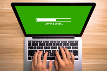 Coming soon Concept Laptop Screen With Typing Hands On Keyboard
