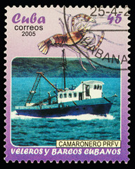 Fishing ship and lobster on postage stamp