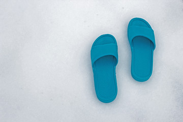 Impatient for Summer - Pale blue sandals on snowy background