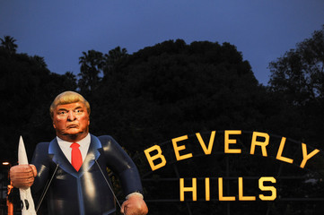 People protest at a park a few miles from a gated community where U.S. President Donald Trump is holding a fundraiser in Beverly Hills