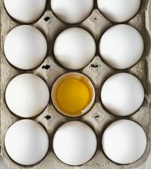 White raw chicken eggs in carton box