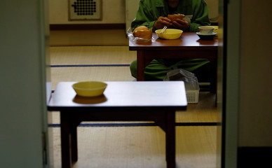 An elderly inmate lunches in a special building set aside for elderly unable to do regular prison factory work what is making shoes, at the Tokushima prison in Tokushima