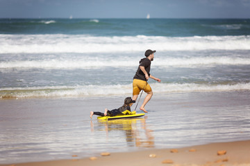 Father and Daughter Surfers, Family time, fun, everyday superhero