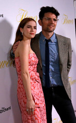 """Cast members Deutch and Scott pose at the premiere for """"Flower"""" in Los Angeles"""
