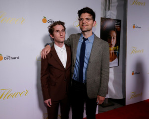 """Cast member Scott poses with director Winkler at the premiere for """"Flower"""" in Los Angeles"""