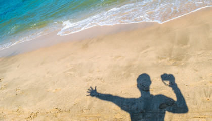 Background of Sand in summer beach holiday with the man traveler and his famous camera