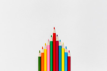 pyramid of colored pencils on white background