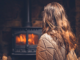 Woman getting warm by the fire