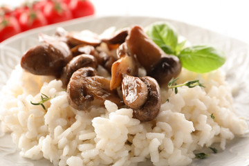 Tasty risotto with mushrooms on plate, closeup