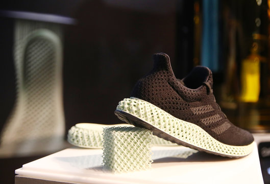 A pair of the sport shoes of Adidas, printed by 3D printer, is seen before the company's annual news conference in Herzogenaurach