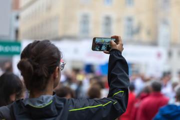 Taking Digital Photograph with Smartphone during Public City Marathon Sport Event