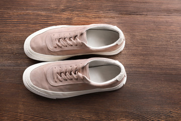 Casual male shoes on wooden floor