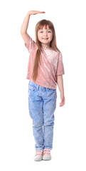 Cute little girl measuring her height on white background
