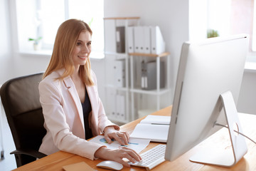 Young woman working in office. Finance trading