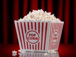 popcorn box on red curtain background