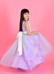 Garden Poster Beautiful little girl model wearing a violet dress