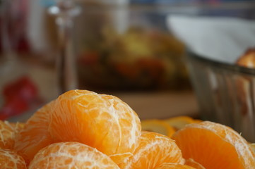 Slices of tangerines. Delicious fruits on the table. Close-up photo. Useful vitamins. Blurred background. Design element.