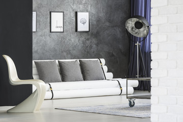 Tripod lamp in monochromatic interior