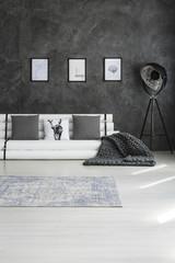 Chunky blanket in minimalist apartment