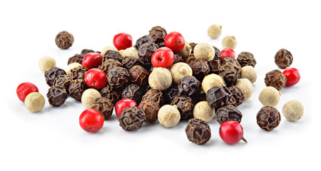 Mix of different peppers. Black, red and white peppercorns isolated on white background. Heap of spice. Full depth of field.