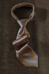 tie on dark background
