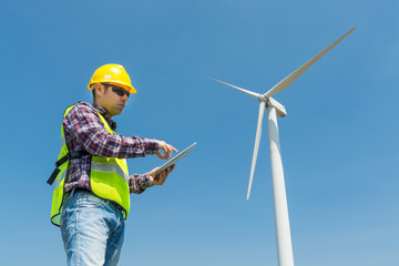 Electric Engineer use Digital Wireless Tablet Device with Wind turbine power Generator