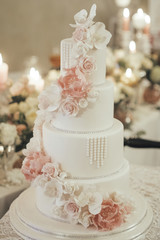 Luxurious wedding cake with marzipan and flower decorations.