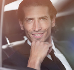 face of a businessman sitting in car