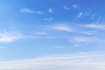 Blue sky with white windy clouds