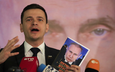 Russian opposition figure Ilya Yashin presents a report ahead of the presidential election in Moscow