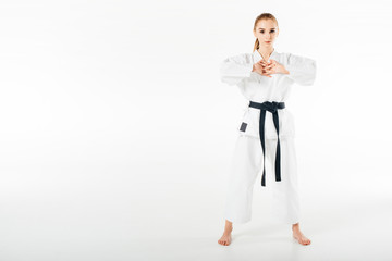 female karate fighter stretching fingers isolated on white