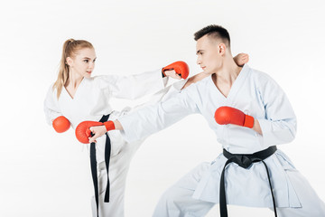 karate fighters exercising isolated on white