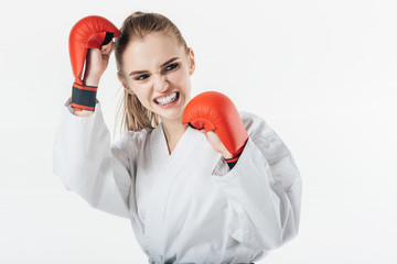 female karate fighter training with gloves and mouthguard isolated on white