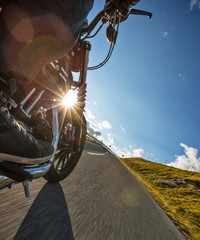 Motorcycle rider driving in Alps