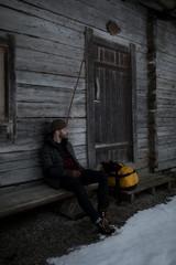 Man outside cabin