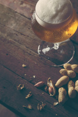 Pale beer and peanuts