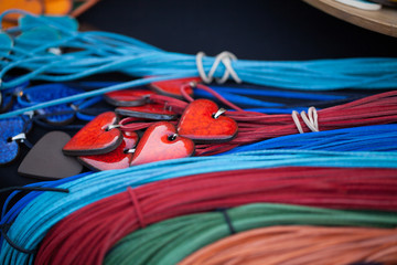 red ceramic hearts on colorful leatherstrap