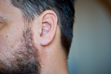 man's ear, close-up