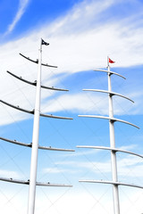Modern sailing boat masts under the blue sky