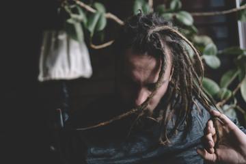 Man shaking hair with dreadlocks
