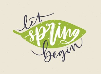 Let Spring Begin lettering written with calligraphic cursive font and decorated by fresh green leaf. Handwritten springtime inscription isolated on light background. Hand drawn vector illustration.