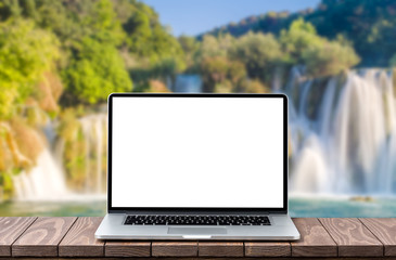 Modern laptop with empty white screen with landscape background