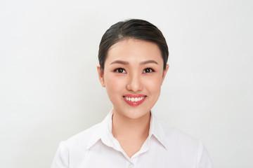 Passport photo. Portrait of asian smiling woman.