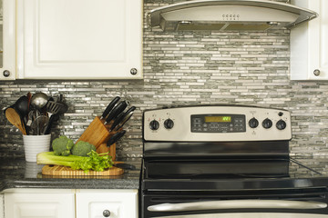 Stainless steel stove and kitchen utensils on the cooking table