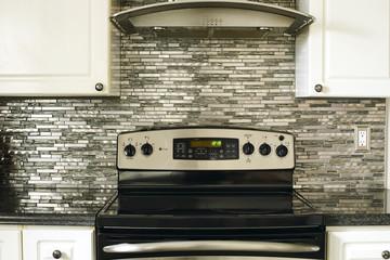 Stove closeup in modern kitchen interior.