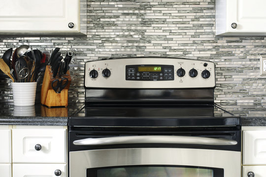 Stove closeup in modern kitchen interior.